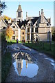 SO8001 : Woodchester Mansion reflected in a puddle by Philip Halling