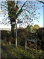 TM2693 : Roadsign & road name sign on Mill Road by Adrian Cable