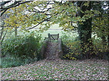ST5906 : Stockwood: bridge and gate to the church by Chris Downer