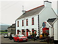 M2208 : Ballyvaghan - White & Red B&B next to Monk's Pub - Side View by Joseph Mischyshyn