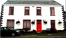 M2208 : Ballyvaghan - White & Red B&B next to Monk's Pub - Front View by Joseph Mischyshyn