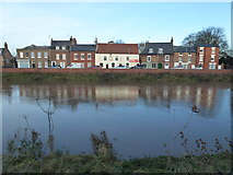 TF4509 : The Red Lion and The River Nene in Wisbech by Richard Humphrey