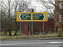 TL2460 : Roadsigns on the A428 Cambridge Road by Adrian Cable