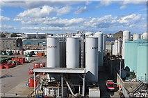 NJ9505 : Oil tanks, Victoria Dock by Richard Webb
