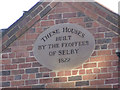 SE6132 : Almshouses, Gowthorpe - inscribed plaque by Alan Murray-Rust