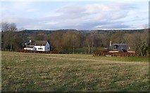 NH5041 : Fields and houses, by Post Office Brae by Craig Wallace