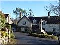 SX8157 : Ashprington memorial cross and the Durant Arms inn by David Smith