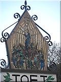 TL3656 : Toft village sign (west side) by Bikeboy