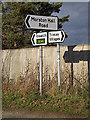 TM2638 : Roadsigns on High Road by Adrian Cable