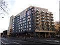 TQ3479 : Bermondsey Spa: Apartment block with Tesco Metro by Stephen Craven