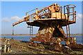 NS3038 : Rusting Crane on Derelict Wharf, Ardeer Peninsula by Leslie Barrie