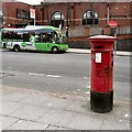 SJ8397 : Victorian Post Box and Green Bus by Gerald England