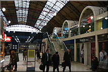 TQ2879 : Wetherspoon's and other shops in Victoria Station by Bill Boaden