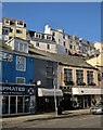 SX9256 : Shops along The Quay at Brixham by Derek Harper