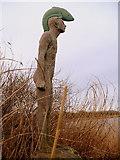 NT6578 : Fish Man statue at Seafield Pond by Brian Turner