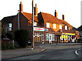 TM4389 : Parade of shops off Rigbourne Hill by Adrian Cable