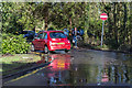 TQ3299 : Large Puddle near Entrance to Car Park at Whitewebbs House, Enfield by Christine Matthews