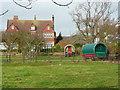 NZ9405 : Gypsy caravans in a back garden by Humphrey Bolton