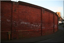 TA0322 : Curved brick wall in Soutergate by Chris