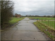 SJ4926 : Concrete road, Sleap by Richard Webb