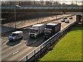 SD8004 : HGVs on Eastbound M60 at Whitefield Interchange by David Dixon