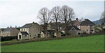 SK2572 : Houses in Baslow by Trevor Littlewood