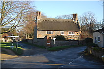 TG2834 : Thatched cottage by N Chadwick