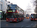 TQ3877 : Greenwich Gyratory - buses by Stephen Craven