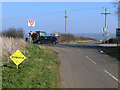 SP8697 : Cross roads over the A6003 by Oliver Dixon
