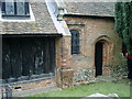TL5302 : Close up of features on south side of Church of St Andrew at Greensted-juxta-Ongar by Clint Mann