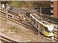 SJ8499 : Metrolink Single Line Working at Victoria by David Dixon