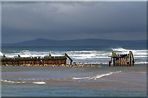 NJ2370 : An old breakwater at Lossiemouth by Walter Baxter