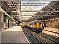 SJ8399 : Victoria Station Platforms 4 and 5 by David Dixon