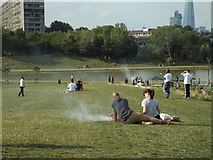 TQ3377 : Sunday barbecues overlooking the lake, Burgess Park by Robin Stott