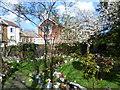 TQ6573 : Memorial garden in Milton Churchyard by Marathon