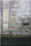 SP5206 : Benchmark on west face of Kings Mill House by Roger Templeman