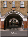 TQ3181 : Arched entrances, Bourne Estate by Julian Osley