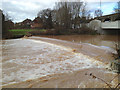 SP3065 : River Leam in spate at Edmondscote Weir, Leamington by Robin Stott
