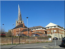 SK3871 : Flats and the spire of the Parish Church of St Mary and All Saints, Chesterfield by Rob Purvis