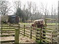 NY8777 : Sheep pens and old railway goods van near St. Giles Church, Birtley by Mike Quinn