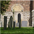 SK7543 : Hawksworth, gravestones and tympanum by Alan Murray-Rust