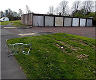 ST2995 : Lockup garages and an abandoned shopping trolley in Pontnewydd, Cwmbran by Jaggery