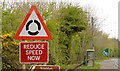 "J1389 : ""Roundabout ahead"" sign, Dunsilly, Antrim (April 2014) by Albert Bridge"