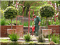 TQ3877 : Watering plants in the Queen's Orchard  by Stephen Craven