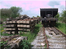 SU1091 : Disused sleepers and rolling stock near South Meadow Lane by Vieve Forward