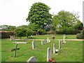 TG0539 : Small cemetery beside Blakeney Road by Evelyn Simak