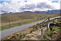 NG4030 : Fence, gates, road and valley by Richard Dorrell