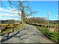 NS4082 : A country road in Balloch by Lairich Rig