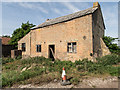 TL5181 : Derelict Farm Building on West Fen Road by Kim Fyson