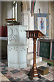 TF9828 : The church of All Saints in Stibbard - lectern and pulpit by Evelyn Simak